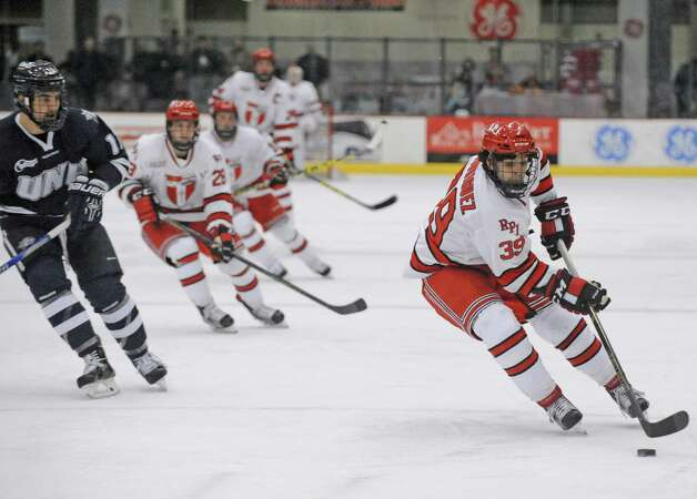 RPI's Alex Rodriguez brings the puck up the ice during their men's college hockey game against New Hampshire at the Houston Field House on Tuesday Nov. 24, 2015 in Troy, N.Y. (Michael P. Farrell/Times Union) Photo: Michael P. Farrell / 10034421A