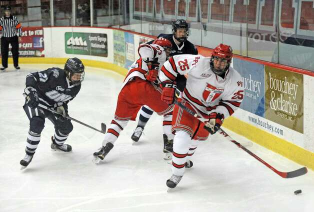 RPI's Drew Melanson brings the puck around the boards during their men's college hockey game against New Hampshire at the Houston Field House on Tuesday Nov. 24, 2015 in Troy, N.Y. (Michael P. Farrell/Times Union) Photo: Michael P. Farrell / 10034421A