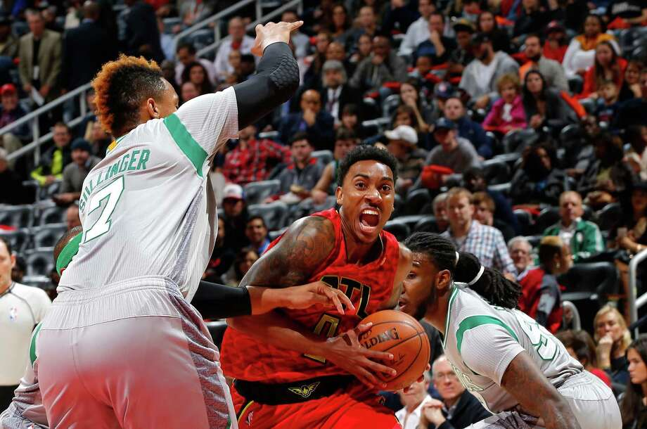 ATLANTA, GA - NOVEMBER 24:  Jeff Teague #0 of the Atlanta Hawks drives between Jared Sullinger #7 and Jae Crowder #99 of the Boston Celtics at Philips Arena on November 24, 2015 in Atlanta, Georgia.  NOTE TO USER User expressly acknowledges and agrees that, by downloading and or using this photograph, user is consenting to the terms and conditions of the Getty Images License Agreement.  (Photo by Kevin C. Cox/Getty Images) ORG XMIT: 575728267 Photo: Kevin C. Cox / 2015 Getty Images