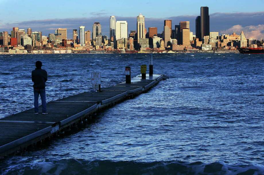 """A """"king tide"""" reached its peak at Seattle's Alki Beach Tuesday afternoon. King tides are a natural phenomenon that occur once or twice a year when the sun and moon's gravitational pulls reinforce one another. Photo: GENNA MARTIN, SEATTLEPI.COM / SEATTLEPI.COM"""