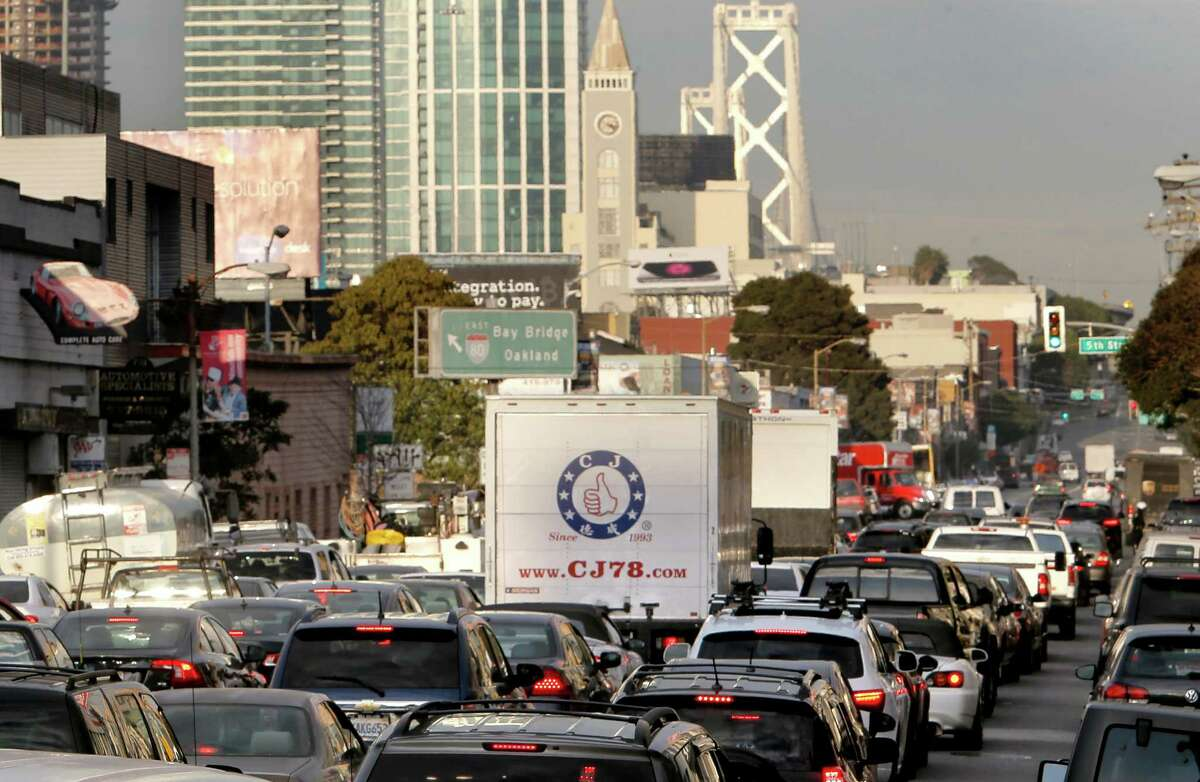 The man stripped naked atop a sign near the Fifth Street on-ramp in San Francisco.