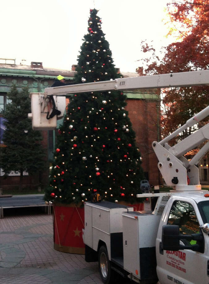 Workers erected a 30-foot tree on Monday at McLevy Square but had to remove it the next day to make room for the inauguration day for Mayor-Elect Joseph P. Ganim. Photo: John Alcott / Hearst Connecticut Media / Connecticut Post