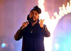 LOS ANGELES, CA - NOVEMBER 22:  Singer The Weeknd performs onstage during the 2015 American Music Awards at Microsoft Theater on November 22, 2015 in Los Angeles, California.  (Photo by Kevin Winter/Getty Images)
