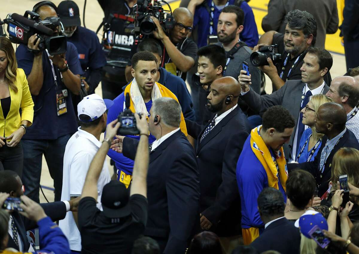 Golden State Warriors' Stephen Curry and Klay Thompson leave the court after 111-77 win over Los Angeles Lakers during NBA game at Oracle Arena in Oakland, Calif., on Tuesday, November 24, 2015.
