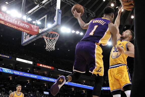 Stephen Curry (30) defends against D'Angelo Russell (1) in the second half as the Golden State Warriors played the Los Angeles Lakers at Oracle Arena in Oakland, Calif., on Tuesday, November 24, 2015.