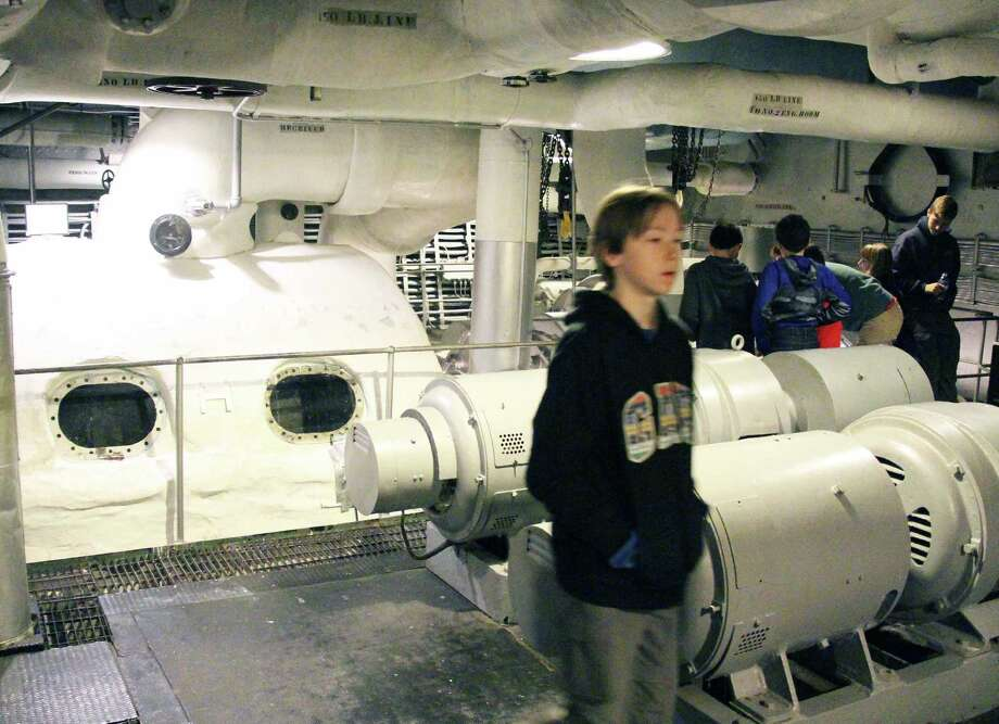 A tour group checks out the engine room of the USS Massachusetts. Photo: Contributed / Contributed Photo / Westport News