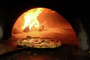 Feds: Man sentenced in Iraqi pizzeria scheme - Photo