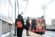 Passengers wait to board a Metro-North train at the Greenwich Train Station, Conn., Friday, Feb. 6, 2015. Five Metro-North passengers were killed on Tuesday night in Valhalla, N.Y., when the train they were riding in struck an SUV on the tracks inside the railway crossing gates. The driver of that vehicle was also killed in the accident.