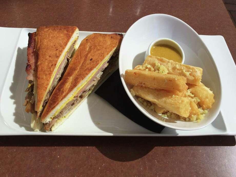 Cuban sandwich with yuca fries at Nao Latin Gastro Bar. Photo: Edmund Tijerina / San Antonio Express-News