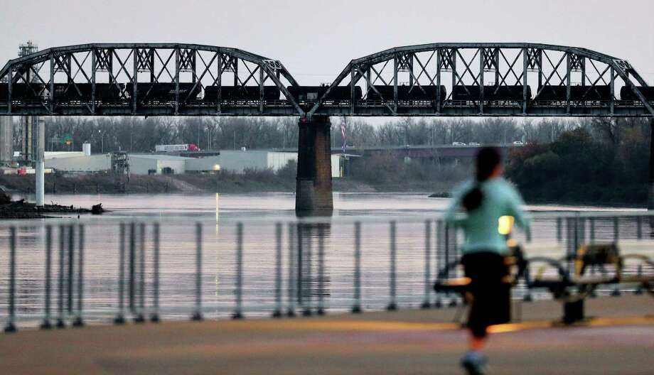 A train travels over a railroad bridge between Council Bluffs, Iowa, and Omaha, Neb., Tuesday, Nov. 10, 2015. A new report from environmental groups is raising questions about the safety of railroad bridges because many appear worn and inspection reports aren't generally available to the public. (AP Photo/Nati Harnik) ORG XMIT: NENH101 Photo: Nati Harnik / AP