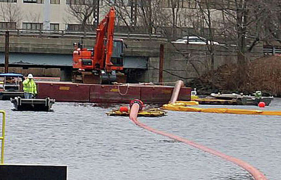 Dredging operations on the Mill River earlier this year, part of the continuing cleanup of toxic materials in the river's sediment. Photo: File Photo / File Photo / Fairfield Citizen
