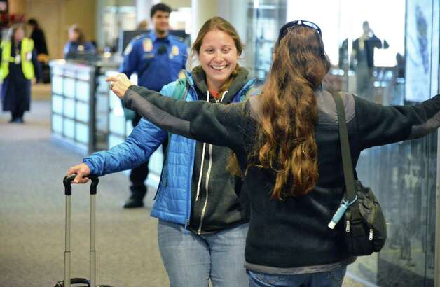 Meagan Mnich of San Francisco rushes to the arms of her mother Judy Mnich of Cohoes as she arrives at Albany International Airport Wednesday Nov. 25, 2015 in Colonie, NY.  (John Carl D'Annibale / Times Union) Photo: John Carl D'Annibale / 10034430A