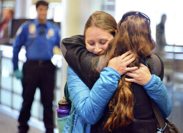 Meagan Mnich of San Francisco hugs her mother Judy Mnich of Cohoes as she arrives at Albany International Airport for Thanksgiving Wednesday Nov. 25, 2015 in Colonie, NY.  (John Carl D'Annibale / Times Union) Photo: John Carl D'Annibale / 10034430A