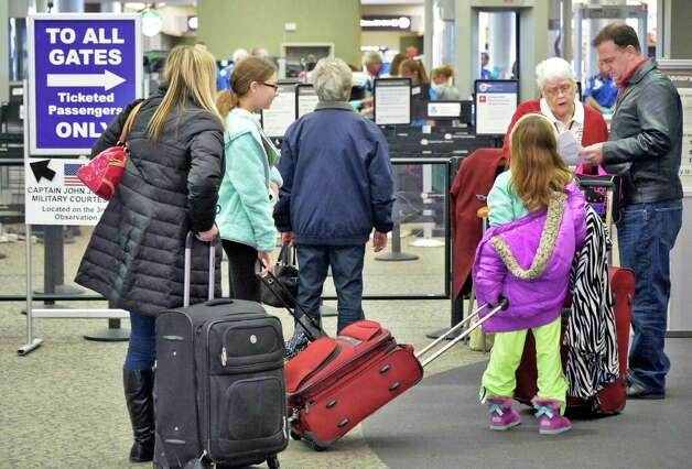 Holiday travelers queue up at ticket counters at Albany International Airport Wednesday Nov. 25, 2015 in Colonie, NY.  (John Carl D'Annibale / Times Union) Photo: John Carl D'Annibale / 10034430A