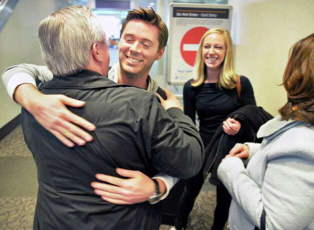 Ken Pelham of Newport Beach, Calif. and girlfriend Annabel Farber are greeted by Ken's parents Roger, left, and Kathy Pelham of Ballston Lake as they arrive for Thanksgiving at Albany International Airport Wednesday Nov. 25, 2015 in Colonie, NY.  (John Carl D'Annibale / Times Union) Photo: John Carl D'Annibale / 10034430A