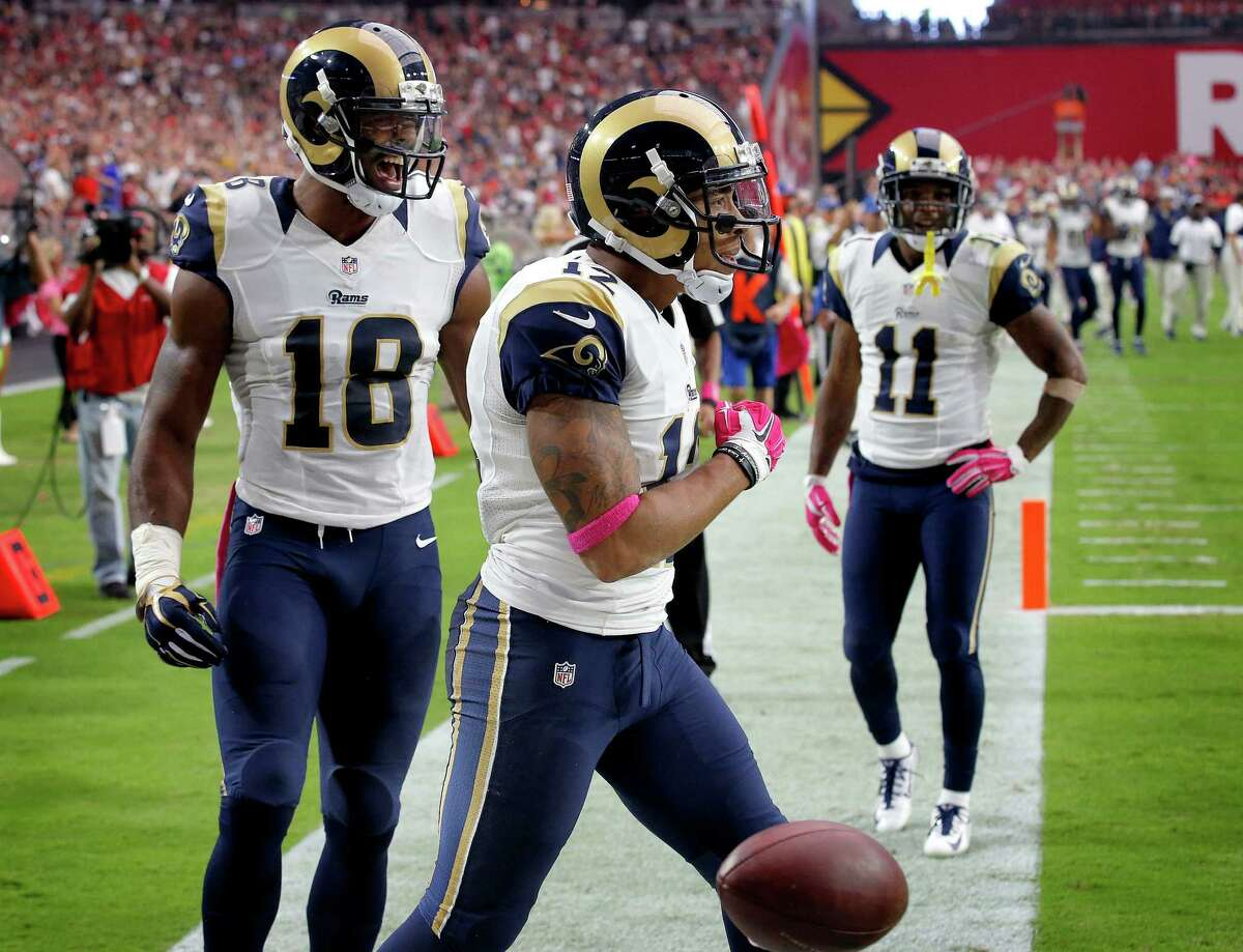 FILE - In this Oct. 4, 2015, file photo, St. Louis Rams wide receiver Stedman Bailey (12) celebrates his touchdown reception with teammates Kenny Britt (18) and Tavon Austin