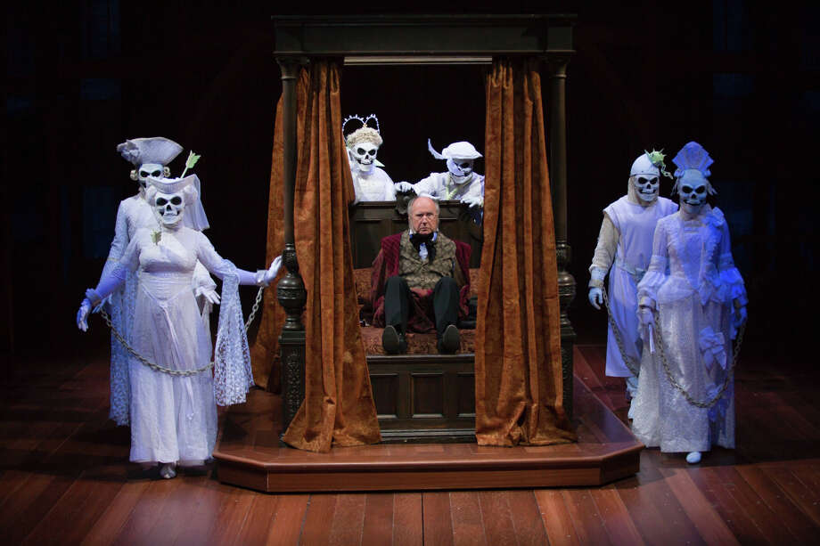 "Ebenezer Scrooge, played by Bill Raymond, has some unwanted company in his bedroom in this scene from ""A Christmas Carol"" at Hartford Stage. The popular show, in its 18th year, opens Friday, Nov. 27 and runs through Sunday, Dec. 27. Photo: T. Charles Erickson / Contributed Photo / The News-Times Contributed"