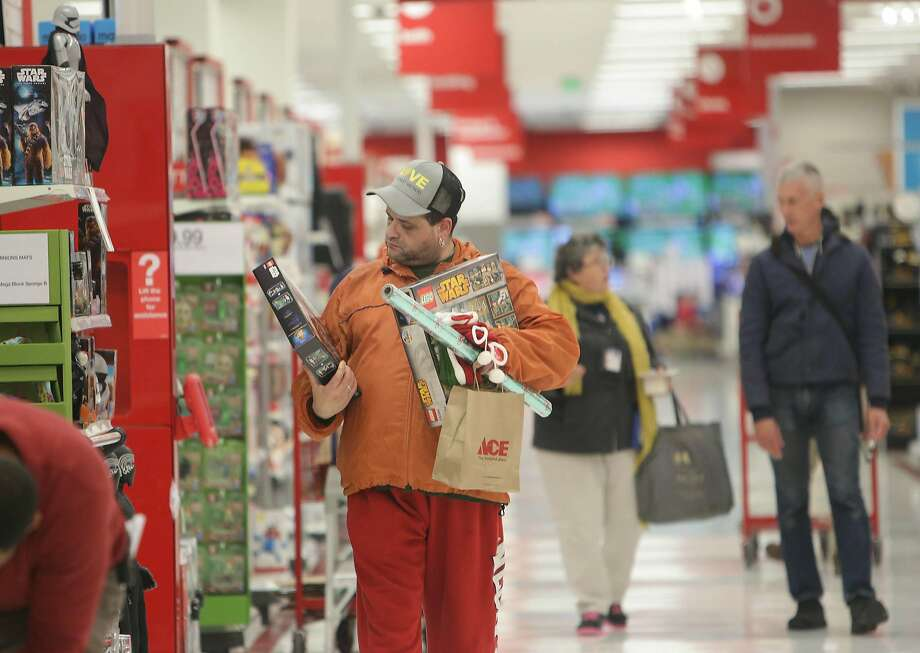 Steven Amuso of San Francisco looks over a a Lego set while shopping at Target on Tuesday, November 24,  2015 in San Francisco, Calif. Photo: Lea Suzuki, The Chronicle