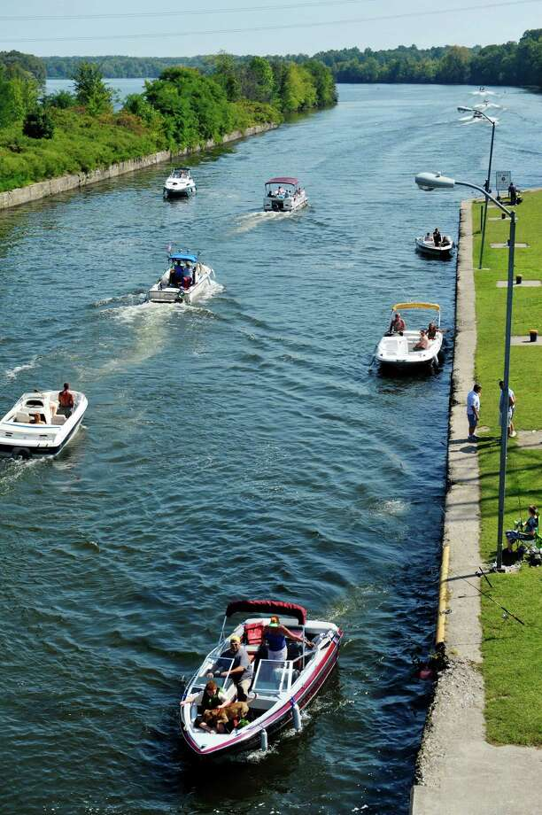 Boaters pilot their boats out of Lock 7 on the Mohwak River as other boaters line up to enter the lock to head west on Sunday, Sept. 6, 2015, in Niskayuna, N.Y.  (Paul Buckowski / Times Union) Photo: Albany Times Union