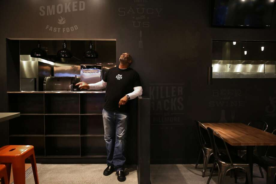 Co-owner chef David Lawrence shows his Black Bark barbecue restaurant. Photo: Liz Hafalia, The Chronicle