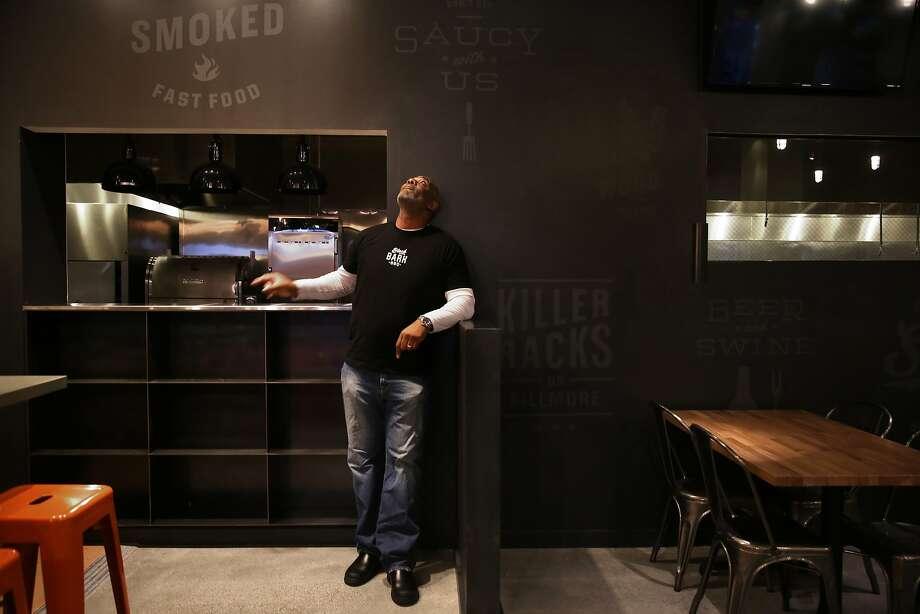 Co-owner chef David Lawrence shows his Black Bark barbecue restaurant. Photo: Liz Hafalia, The Chronicle
