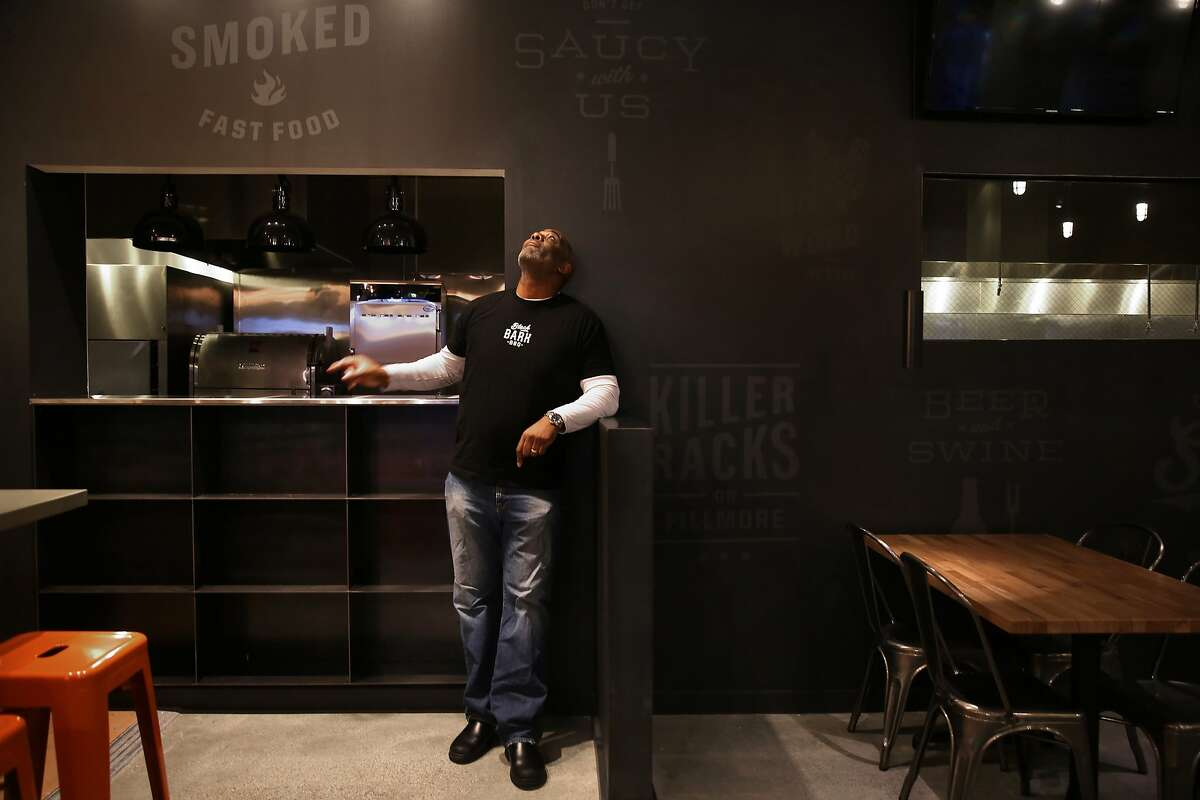Co-owner chef David Lawrence shows his soon to open BBQ restaurant Black Bark in San Francisco, California, on Tuesday, November 24, 2015. Text on the wall is from him and his wife and staff.
