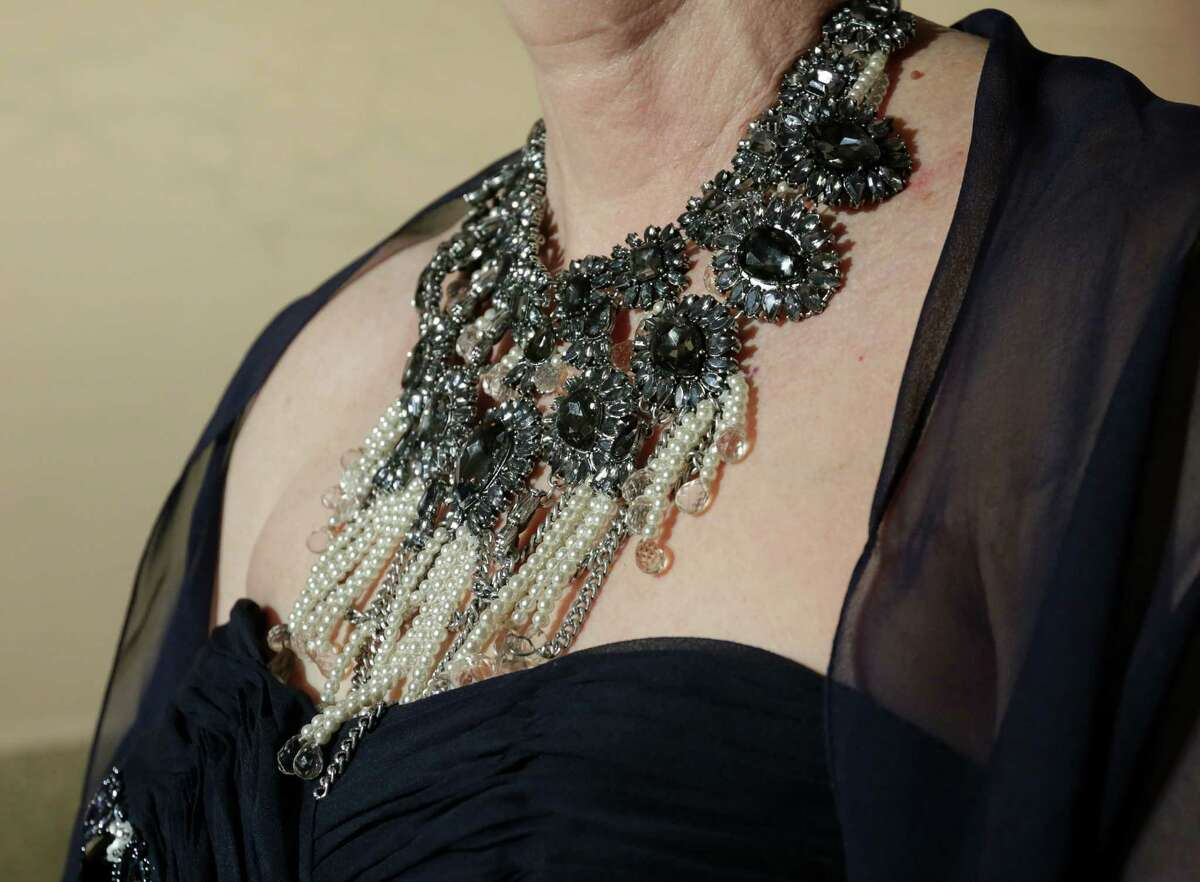 Lucy Buchanan shows off her necklace at the Latin American Experience Gala at the Museum of Fine Arts Houston.