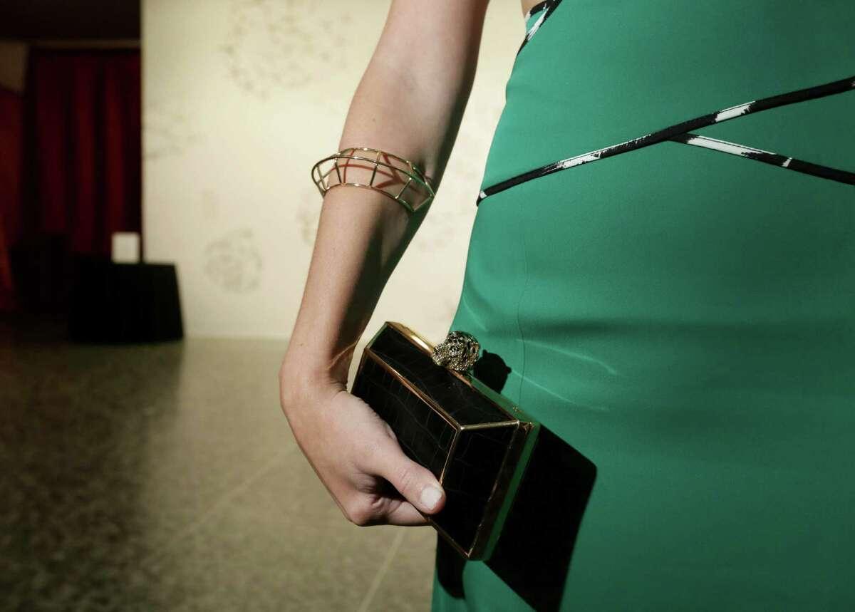 Natalia Ramirez shows off a BCBG handbag at the Latin American Experience Gala at the Museum of Fine Arts Houston.