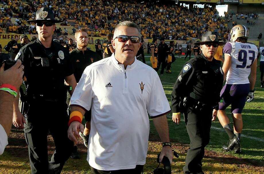 Arizona State head coach Todd Graham runs on the field after a win to shake hands with the Washington coach after an NCAA college football game Saturday, Nov. 14, 2015, in Tempe, Ariz.  Arizona State defeated Washington 27-17. (AP Photo/Ross D. Franklin) Photo: Ross D. Franklin / Associated Press / AP