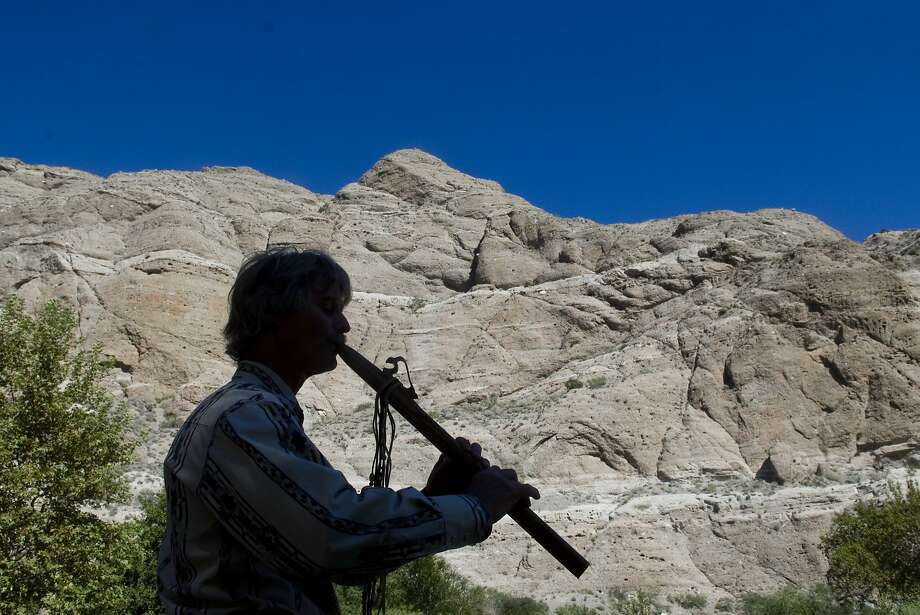 Brian Woodyard  of Desert Hot Springs plays flute at Senator Diane Feinstein's public comment meeting at The Wildlands ConservancyÕs Whitewater Preserve near Palm Springs on Tuesday. Feinstein was seeking support for her desert protection bill which will create three new national monuments.   (James Quigg, Daily Press) Photo: James Quigg, Victorville Daily Press