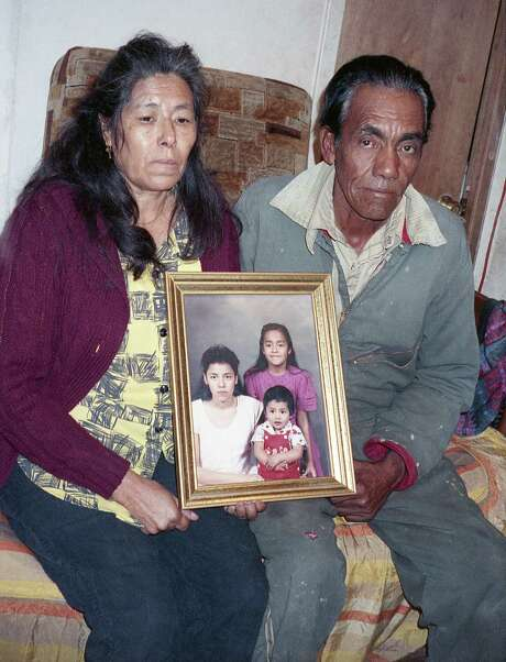 11/29/1990 - Photo: Maria Elena Diaz and her husband, Pedro Diaz hold a picture of their children including their missing daughter Rosemary Diaz on Nov. 29, 1990 Photo: John Toth, Houston Chronicle / Houston Chronicle