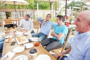 (From left) David Caceres of La Panaderia, CommonWealth Coffeehouse & Bakery general manager Jefferson Arreola, baker Vincent Lacoste and Jeremy Mandrell of Bakery Lorraine, discuss what makes a great croissant Thursday Nov. 12, 2015 during a meeting of the top four croissant makers at CommonWealth Coffeehouse & Bakery.