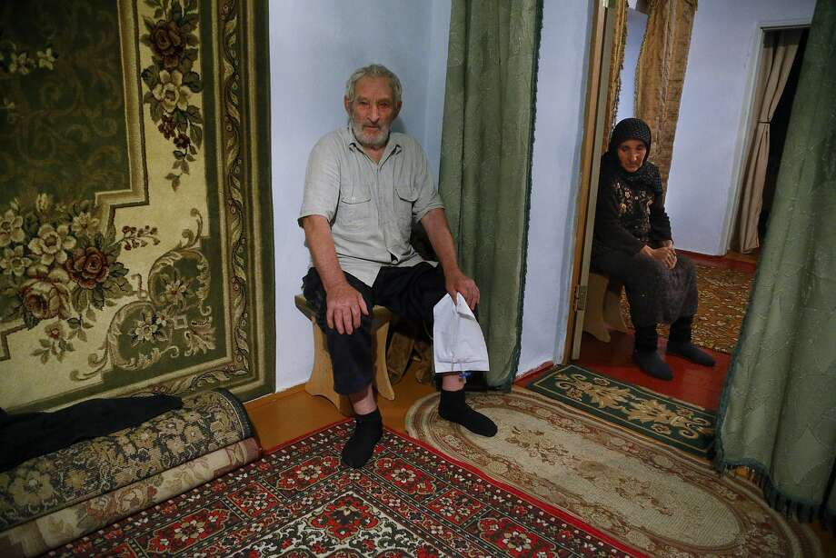 Zaynudin Magomedov with his wife, father of Rashid Magomedov who left to become an Islamic State fighter and was killed in Syria, speaks at home in the village of Komsomolskoye, Dagestan, Russia. An epidemic of recruitment for the Islamic State group has swept through the predominantly Muslim area where young men and women are leaving for Syria, pursuing a religious ideal or trying to escape police profiling. Photo: Sergei Grits, Associated Press