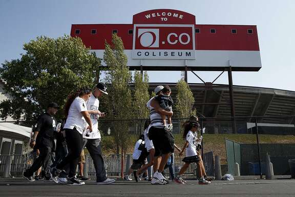 Fans arrive for the Oakland Raiders' preseason game at O.co Coliseum in Oakland, Calif., on Sunday, Aug. 30, 2015.