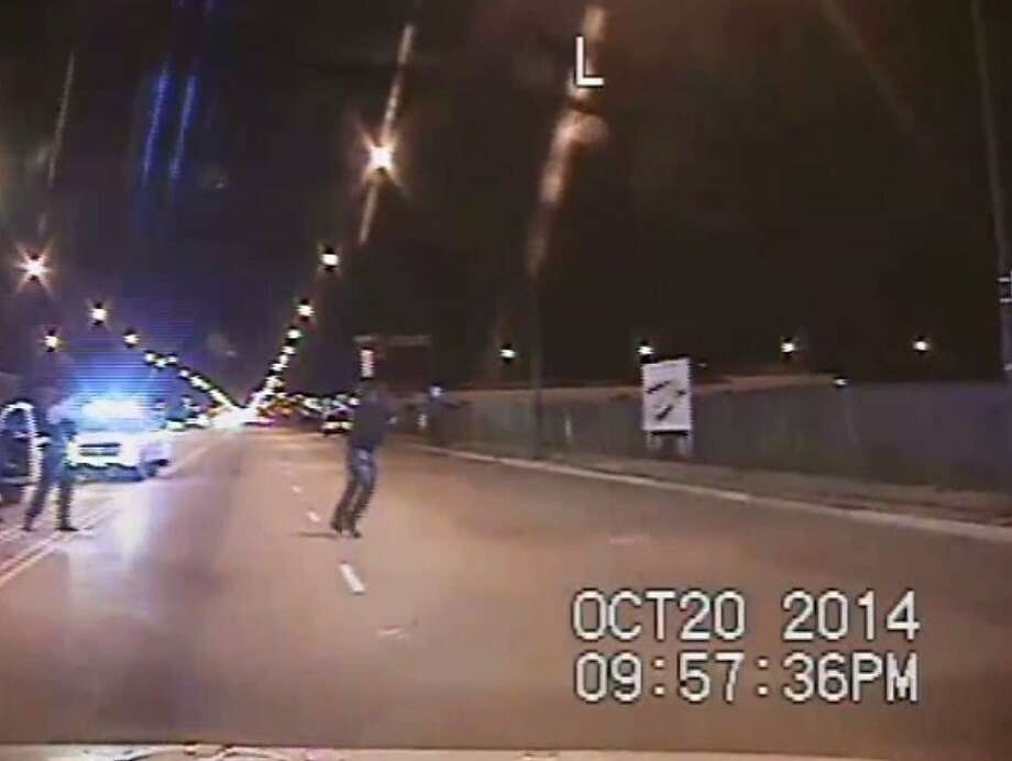 CHICAGO, IL - OCTOBER 20:  In this still image taken from a police vehicle dash camera released by the Chicago Police Department on November 24, 2015 ,  Chicago Police officer Jason Van Dyke shooting is shown shooting Laquan McDonald on October 20, 2014  in Chicago, Illinois. Officer Van Dyke was charged  with first degree murder for the October 20, 2014 shooting in which McDonald was hit with 16 bullets. Photo: Handout, Getty Images
