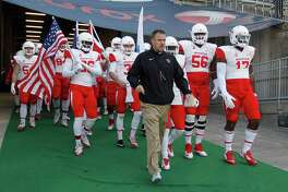 Houston head coach Tom Herman leads his team onto the field prior to an NCAA college football game against Connecticut Saturday, Nov. 21, 2015, in East Hartford, Conn.  (AP Photo/Stew Milne)