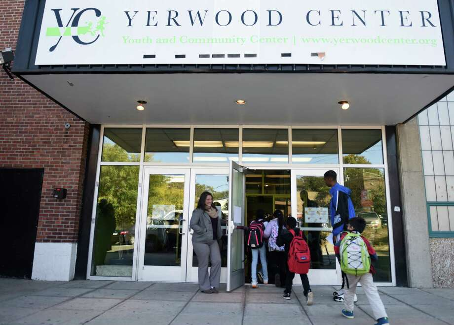 Children enter the Yerwood Center in Stamford after school on Monday, Oct. 19, 2015. After being closed for more than a year, the Yerwood Center opened its doors again with the Boys & Girls Club running an after-school program out of the building. Photo: Tyler Sizemore / Hearst Connecticut Media / Greenwich Time