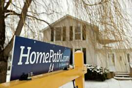 A HomePath sign outside a foreclosed home for sale in Princeton, Illinois.
