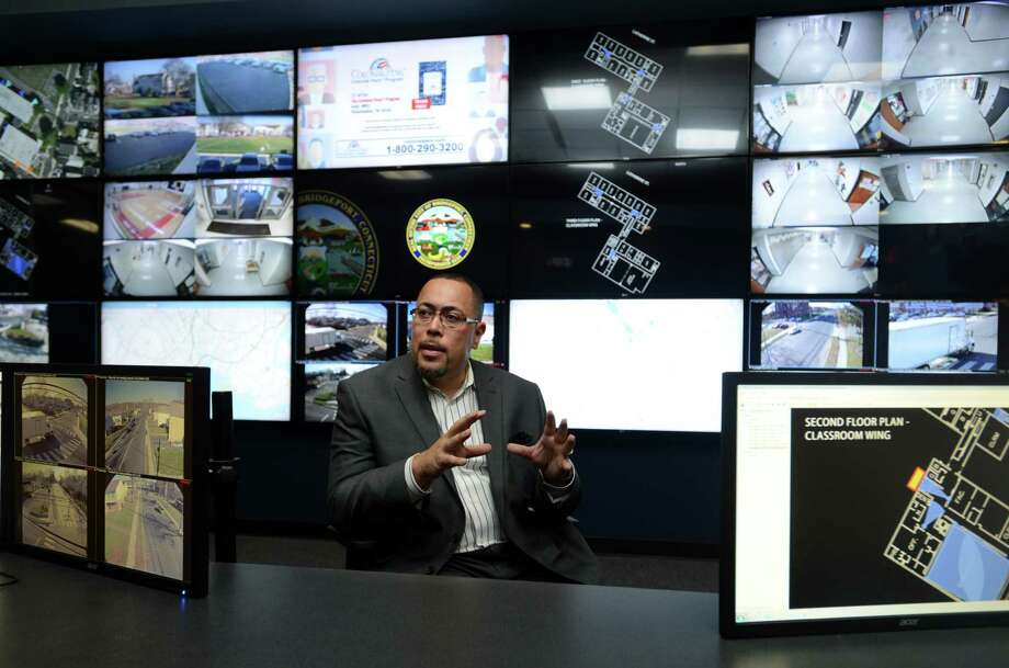 Jorge Garcia, Bridgeport's director of public facilities, talks about the city's new BSAFE Video Security Command Center Wednesday, Nov. 25, 2015, at the Margaret Morton Government Center. Photo: Autumn Driscoll / Hearst Connecticut Media / Connecticut Post