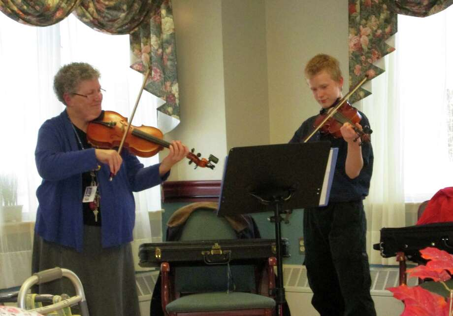On Nov. 16, the Center for Nursing and Rehabilitation at Hoosick Falls enjoyed a fiddle duo: Martha Von Schilgen and Johnathan Warner from Hoosick Falls High School performed tunes that ranged across the continents from France, Ireland, English and America. Residents were tapping their feet and hands in response to the upbeat music that Johnathan arranged.