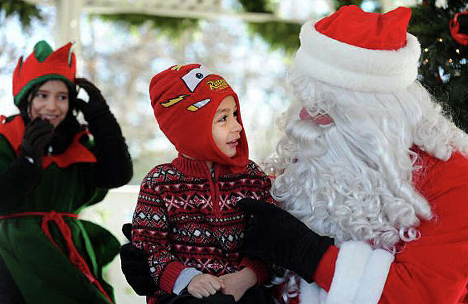 Santa Claus will greet fans, as he did in this photo during an earlier visit, when he comes to town for the holiday season Saturday. Photo: File Photo / File Photo / Fairfield Citizen