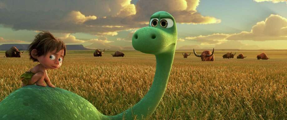 """This image released by Pixar-Disney shows Spot, voiced by Jack Bright, left, and Arlo, voiced by Raymond Ochoa, in a scene from """"The Good Dinosaur."""" (Pixar-Disney via AP) ORG XMIT: NYET176 Photo: Pixar / Disney"""