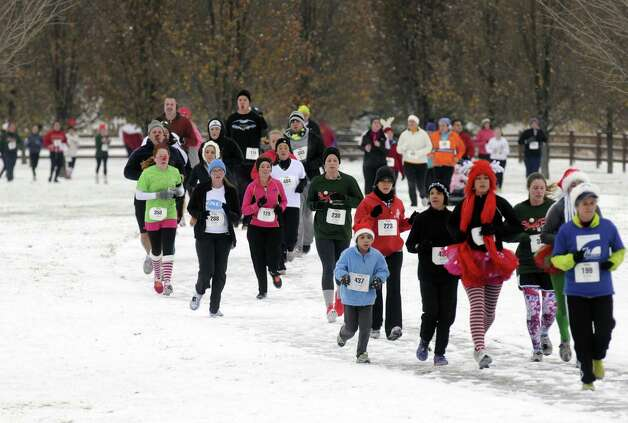 Runners take part in the 2012 Jingle Bell Run/Walk to benefit the Arthritis Foundation of Northeastern New York at the Crossings in a Colonie, NY Saturday Dec. 1, 2012. (Michael P. Farrell/Times Union) Photo: Michael P. Farrell / 10020301A