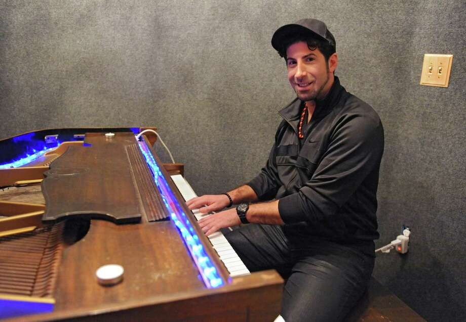 """Record producer Eddie """"Angelikson"""" Cascio plays the piano at the Recording Studio of Albany on Tuesday, Nov. 17, 2015 in Albany, N.Y. He produced some tracks for the final album by Michael Jackson and was friends with him growing up. (Lori Van Buren / Times Union) Photo: Lori Van Buren / 00034281A"""