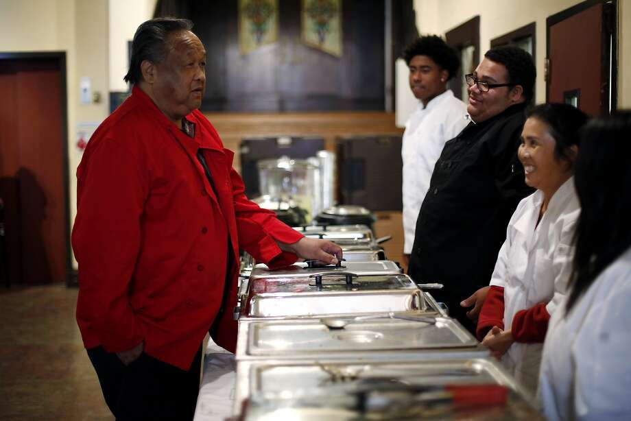 Bill Lee talks to his servers over the food he prepared for a Thanksgiving dinner at Cadillac Hotel in San Francisco, California, on Wednesday, Nov. 25, 2015. Photo: Connor Radnovich, The Chronicle