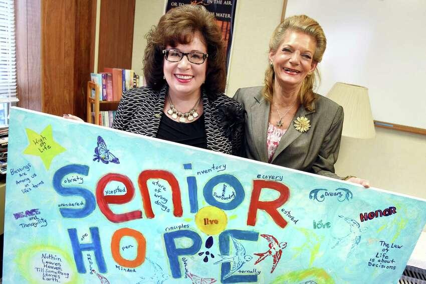 Executive director Nicole McFarland, left, and successful program graduate Sherri Finkel hold artwork honoring Senior Hope on Tuesday, Nov. 24, 2015, at Senior Hope in Albany, N.Y. (Cindy Schultz / Times Union)