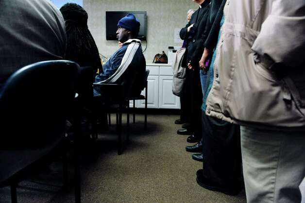 Fired Wal-Mart employee Thomas Smith sits with representatives from community, faith, labor groups and elected officials as they hold a press conference at the Center for Law & Justice on Tuesday, Nov. 24, 2015, in Albany, N.Y.  Those attending the press conference are calling on Walmart to issue an apology and to reinstate Thomas Smith as an employee at anther Walmart location in the area. (Paul Buckowski / Times Union) Photo: PAUL BUCKOWSKI / 10034416A