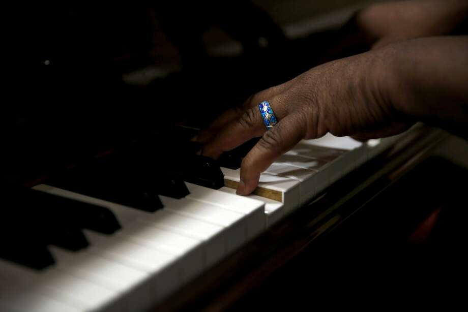 Terrance Kelly plays the piano during warmups for an Oakland Interfaith Gospel Choir practice at the Imani Community Church in Oakland, California, on Monday, Nov. 2, 2015. Photo: Connor Radnovich, The Chronicle