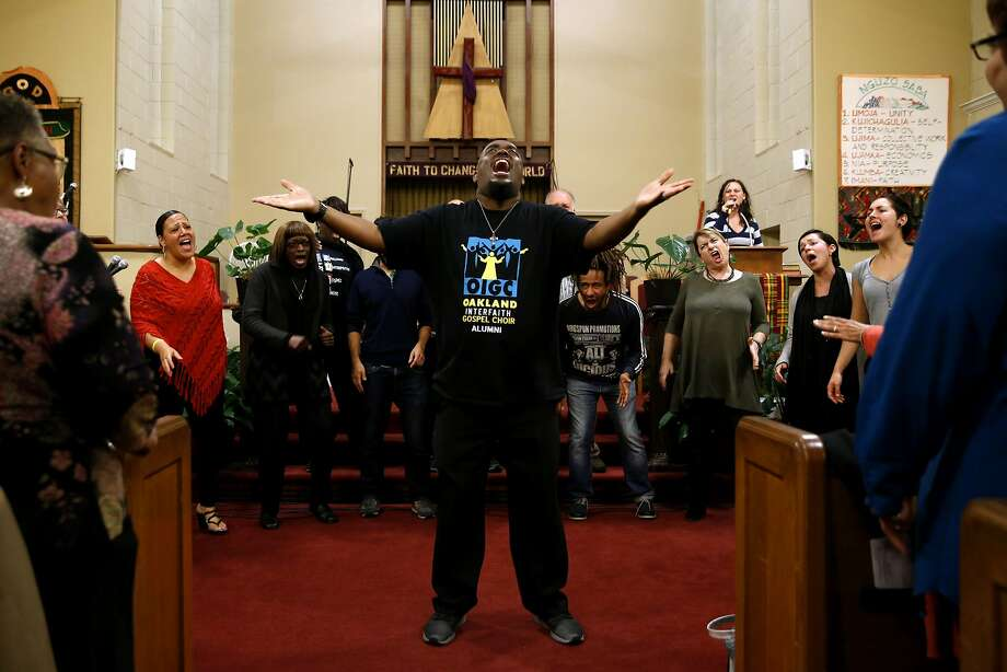 Terrance Kelly leads an Oakland Interfaith Gospel Choir practice at the Imani Community Church in Oakland. Photo: Connor Radnovich, The Chronicle