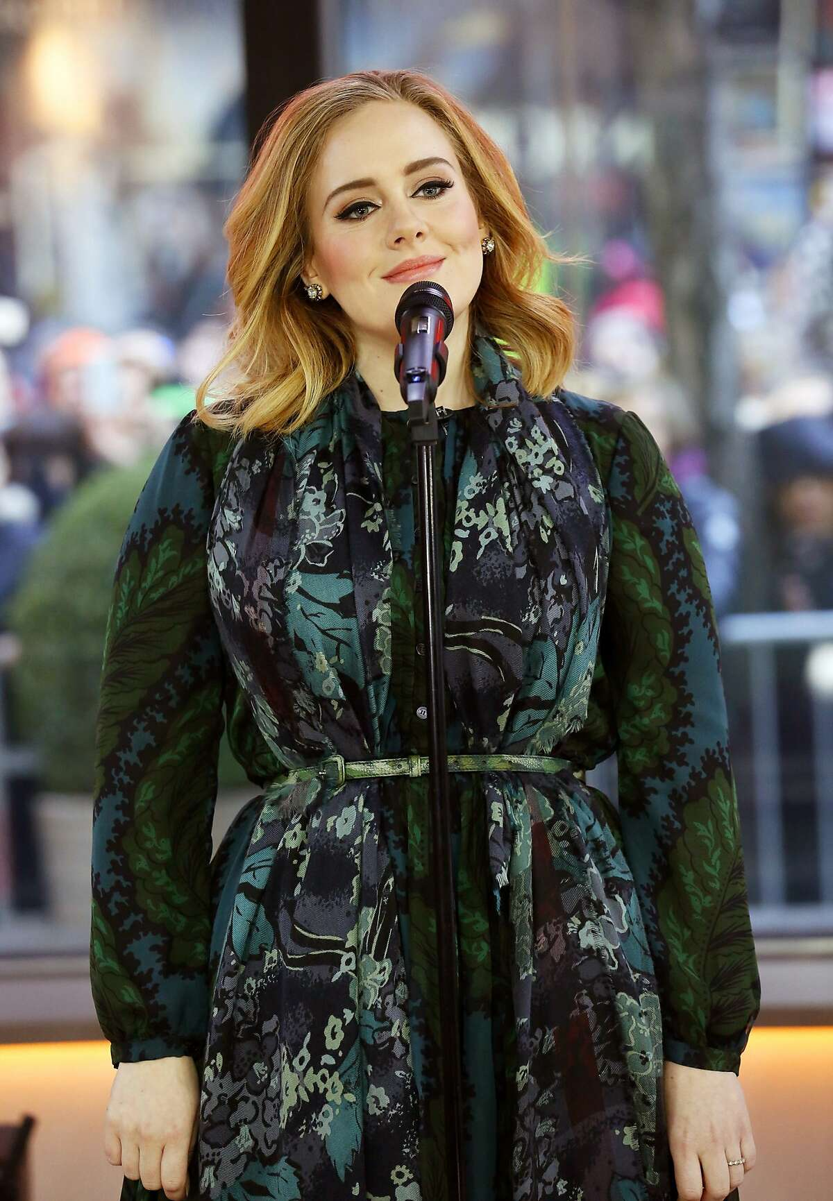 """In this image released by NBC, Adele performs on the """"Today"""" show on Wednesday, Nov. 25, 2015, to promote her latest release, """"25."""" (Heidi Gutman/NBC via AP)"""